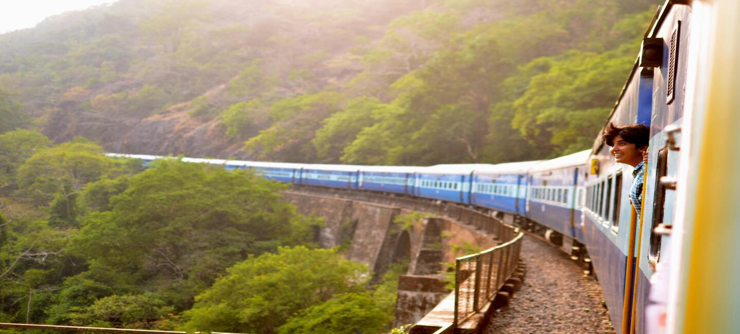 Train passing by a scenic landscape
