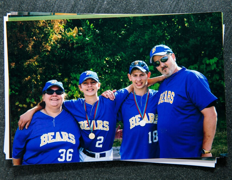 """A family of four wearing softball uniforms adorned with the word """"Bears."""""""