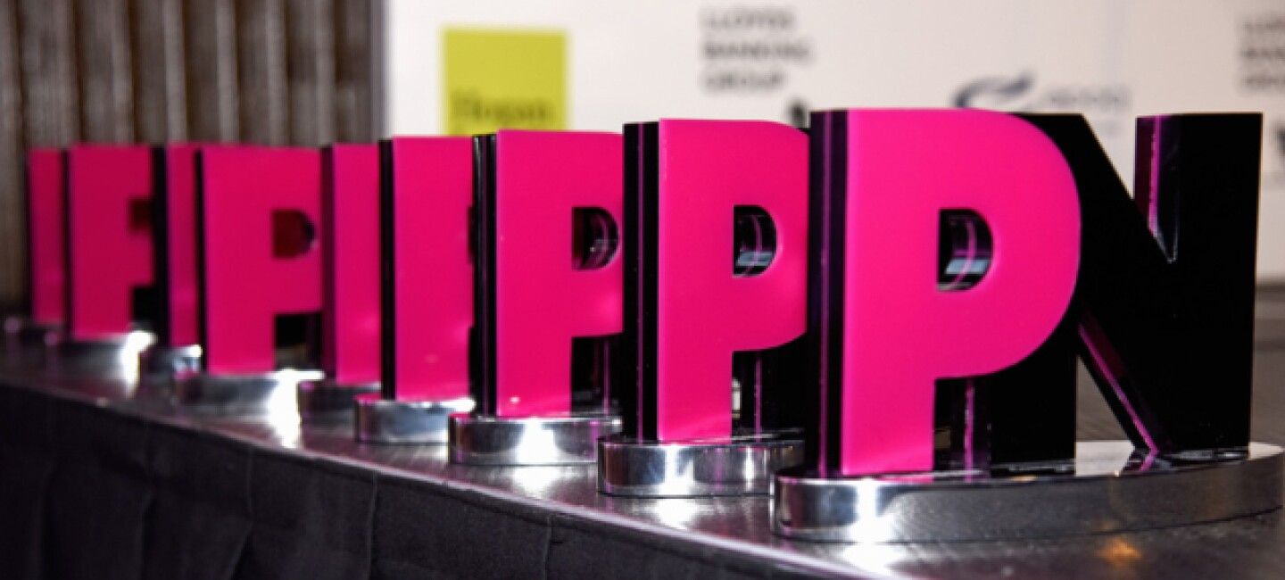 Pink News Business Equality Awards lined up on a table