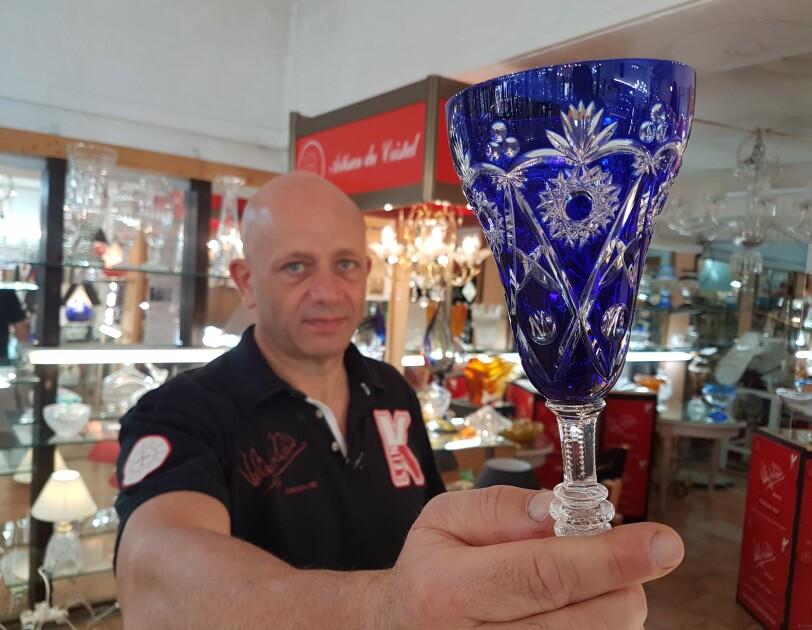 Valery Klein presenting crystal items he crafts