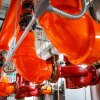 Orange pipes in Amazon's Doppler office building used in Amazon's district energy heating and cooling system.
