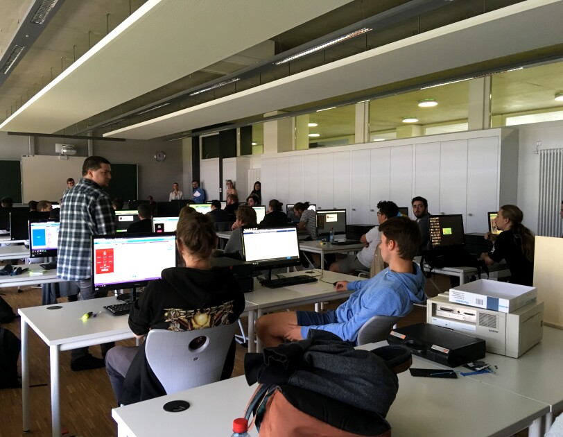 Students practice coding with Amazon employees during the Hour of Code session at the lab of Lenster Lycee Luxembourg