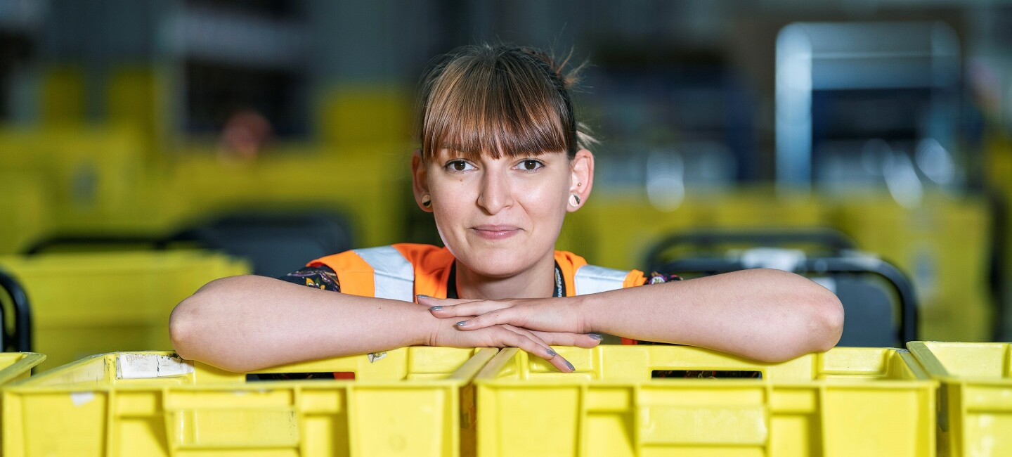 Anca Valeria Sanpetrean, fulfilment centre employee at Amazon in Daventry, pictured at work