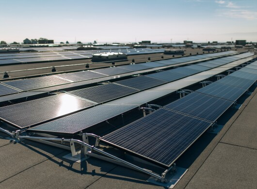 Solar panels on the rooftop of an Amazon fulfillment center