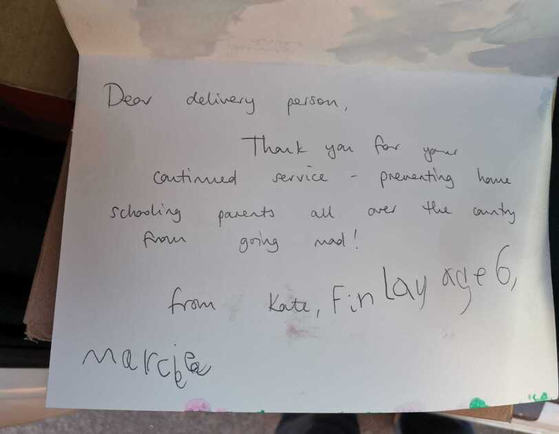 A handwritten thank you note to an Amazon delivery driver signed by two young children.