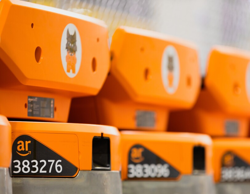 """Three pieces of orange-colored machinery lined up. Each is labeled with the letters """"ar"""" and a series of numbers."""