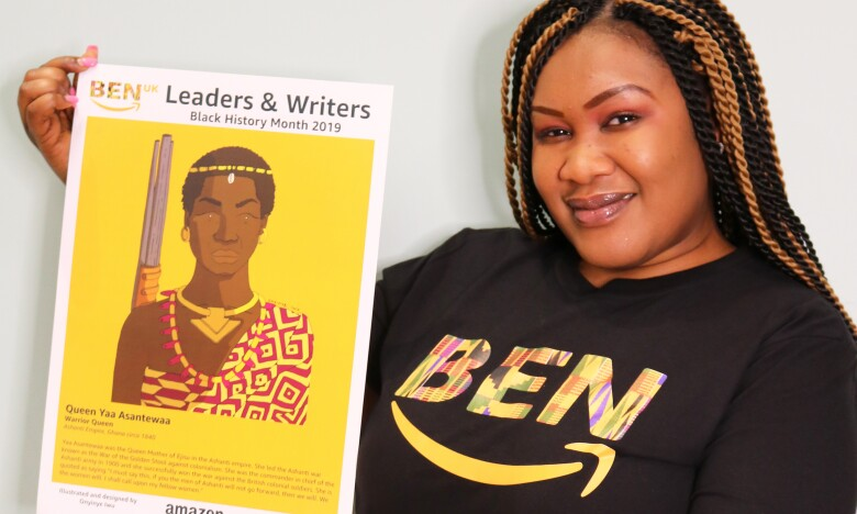 Lucinda Opoku-Ababio, Internal IT Recruiter, holding an artwork of Queen Mother Yaa Asantewaa