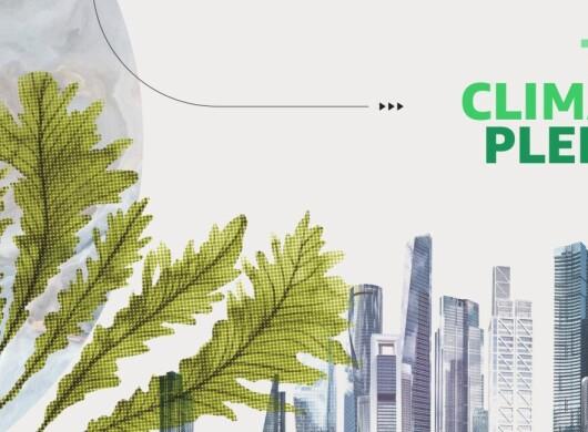 Immagine che include il logo del Climate Pledge