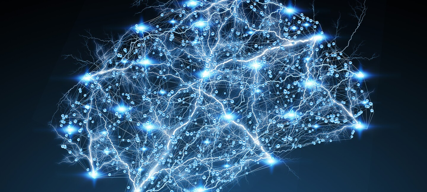 An image that resembles a brain in shape, with points of light along pathways. The background is dark blue.