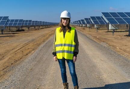 Alcalá de Guadaira Spain Solar Park. An employee stands in a field of solar arrays.