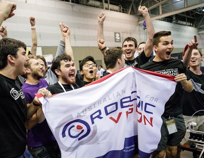 A group of Australian students cheer after winning the Amazon Robotics Challenge.