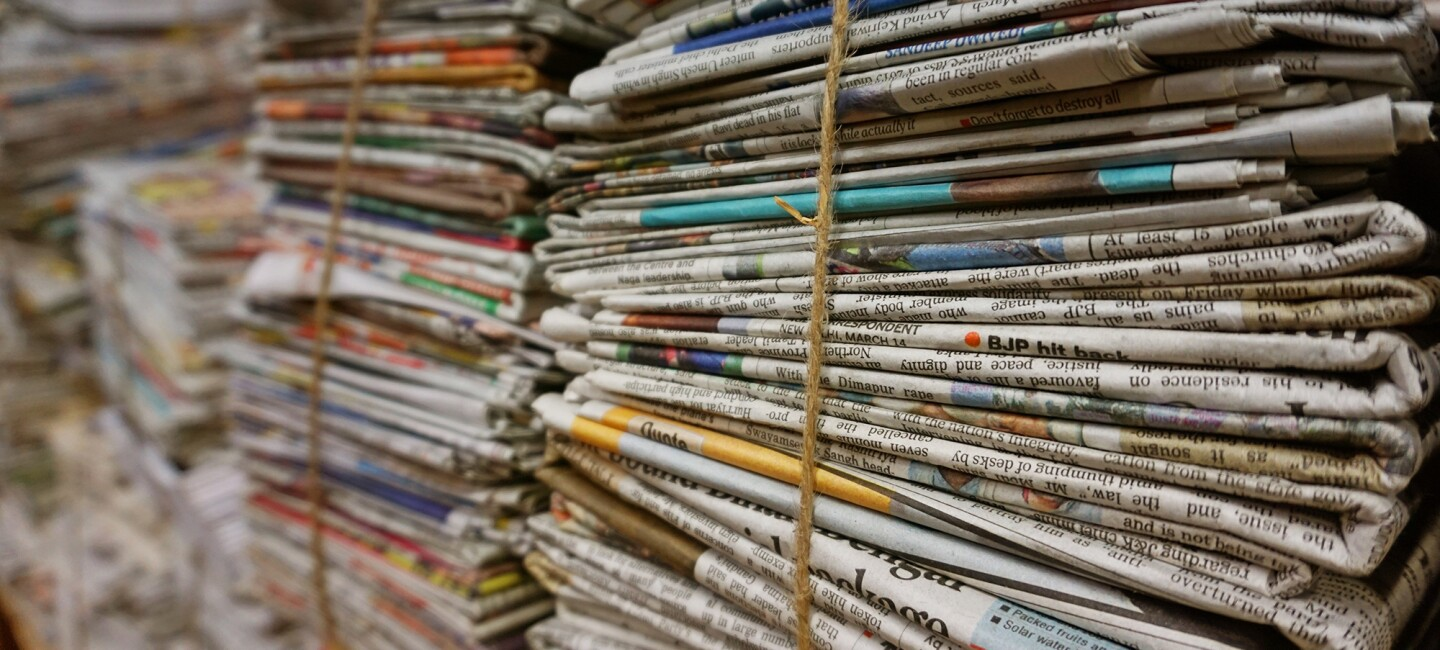 Stacks of newspapers bundled together
