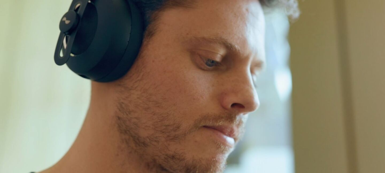 Person listening to NURA headphones