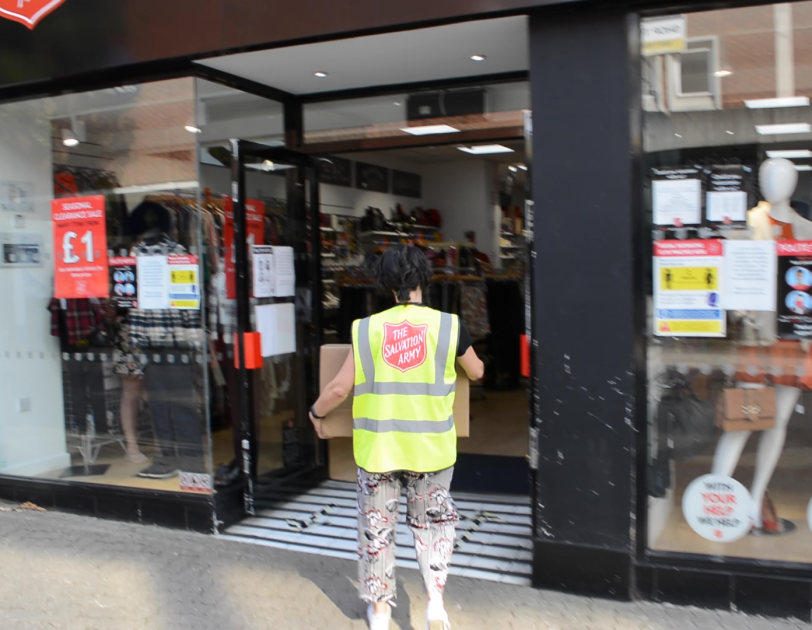 FBA Donations being delivered to a Salvation Army store in the UK. The person carrying the delivery box is wearing a hi-vis jacket with the Salvation Army logo.