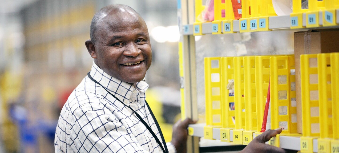 Francis Mensah, fulfilment centre employee at Amazon in Hemel Hempstead, pictured at work