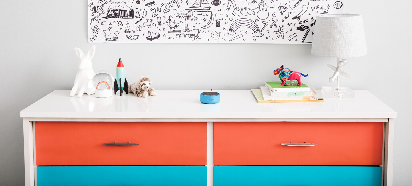 Amazon Echo Dot Kids Edition, an Alexa-enabled device, on a dresser