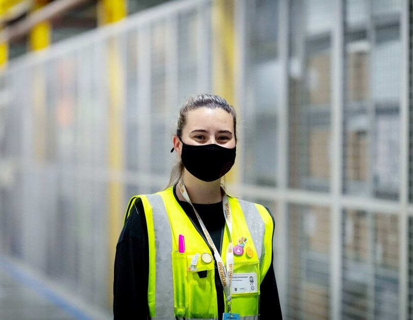 Natalie Emmerman, Area Manager at Amazon's fulfilment centre in Tilbury, pictured wearing a high visibility vest and a face mask.
