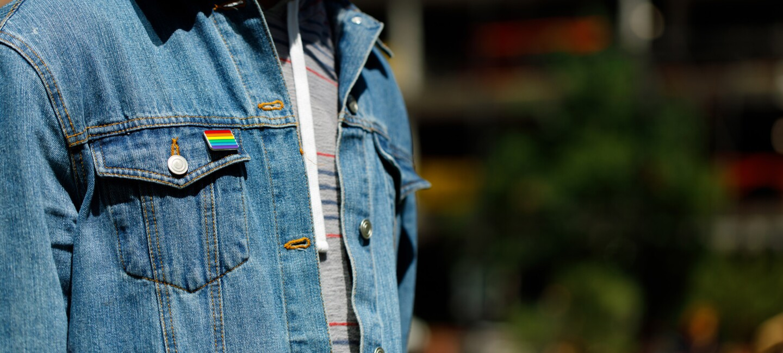denim jacket with rainbow flag on pocket to support glamazon