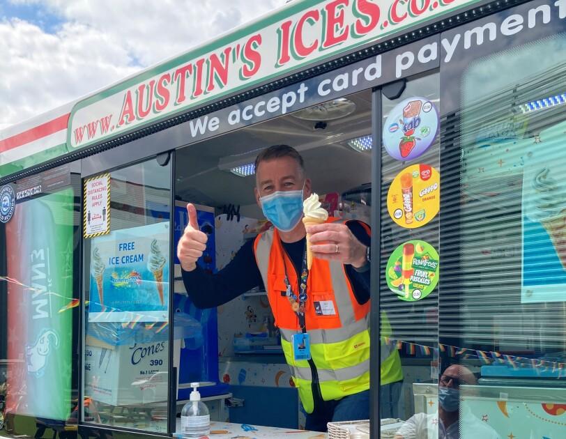 Mark Chew inside ice cream van at MAN3 holding an ice cream