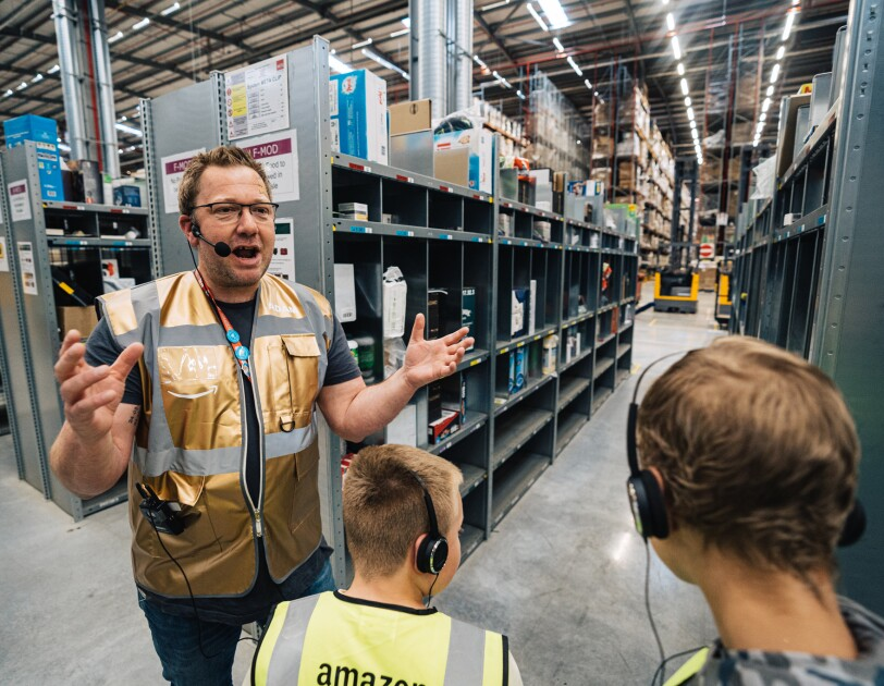 Amazon staff member with children at Amazon Goes Gold event