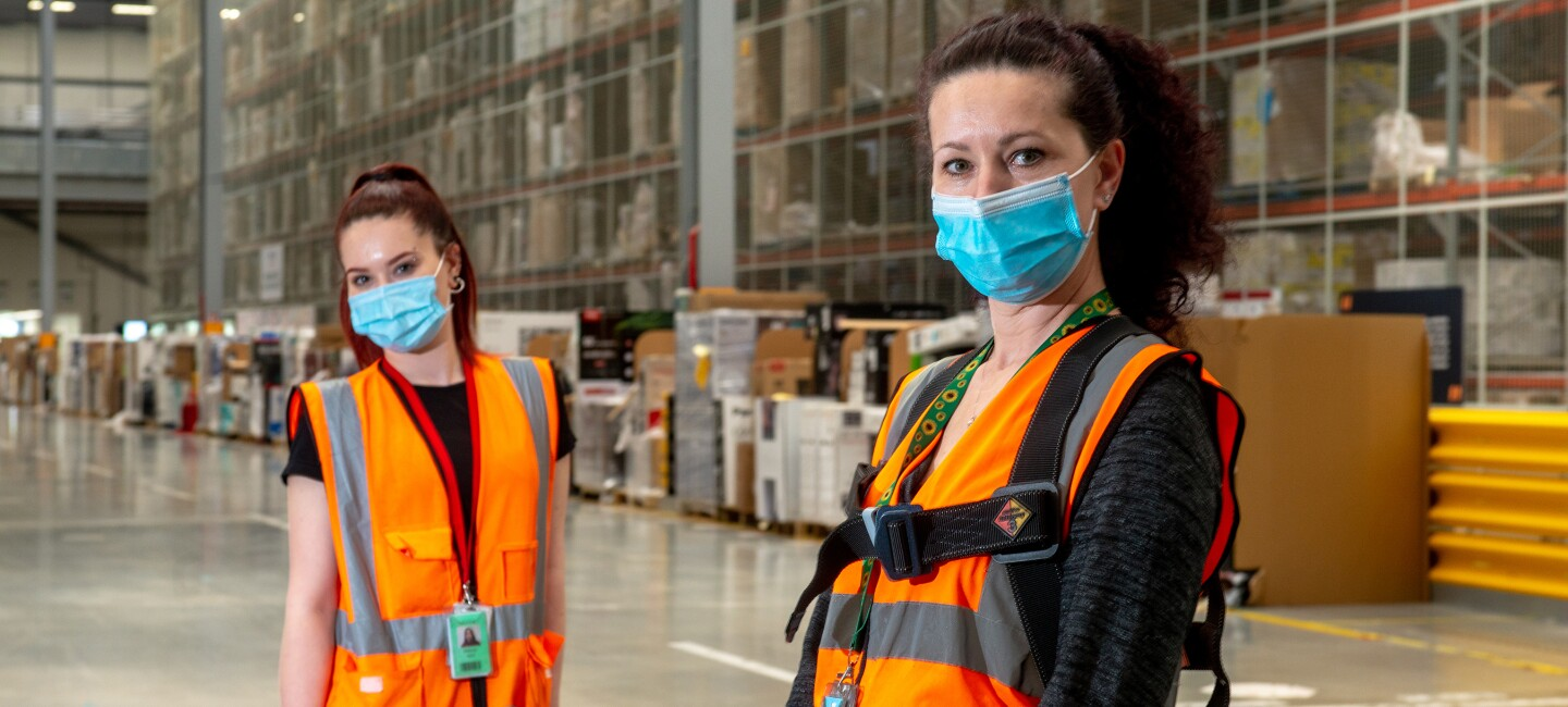Raluca Nica, FC Associate at Amazon's fulfilment centre in Doncaster pictured on the left, with her mother and colleague, Mihaela, on the right.