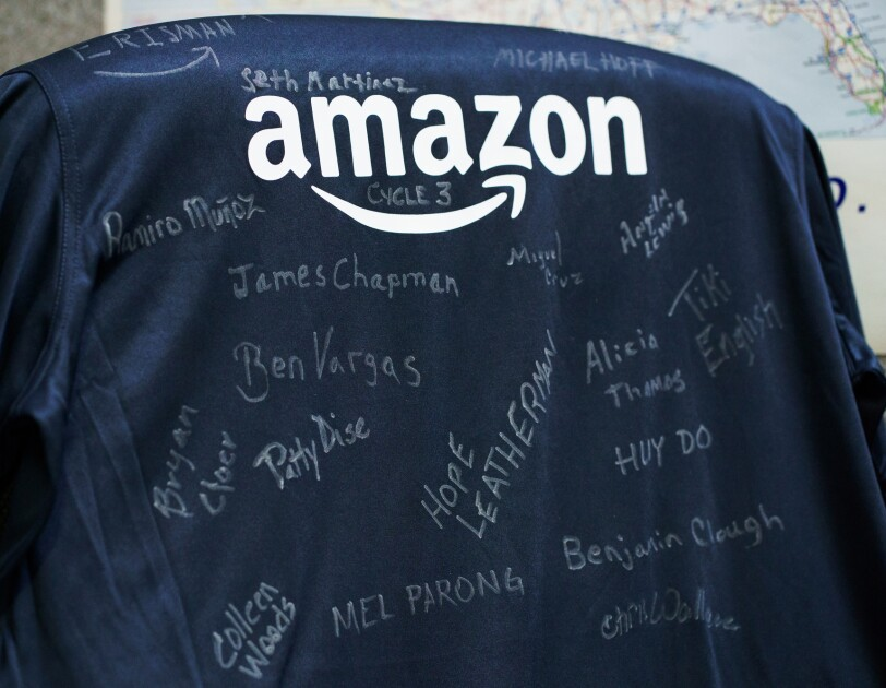 A T-shirt with the Amazon logo and more than a dozen signatures.