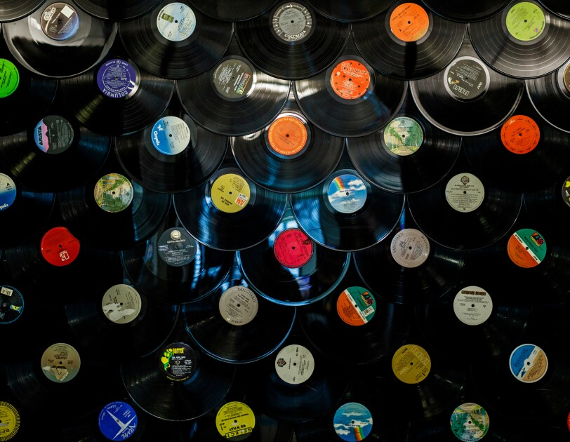 An array of vinyl records shot from above.