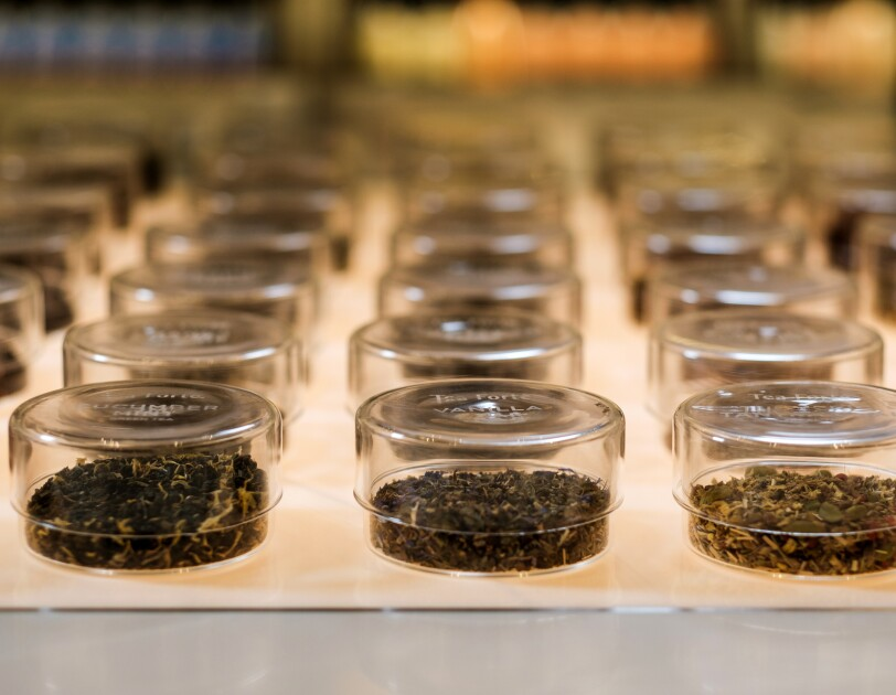 Clear, lidded containers hold loose-leaf tea.