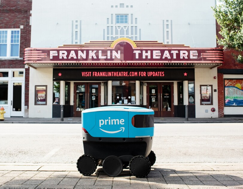 Amazon Scout bot posed in front of iconic landmarks