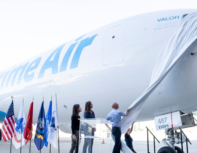 """Jeff Bezos unveils the name of a new Prime Air plane, """"Valor"""" at an event to announce the plane on Veterans Day."""
