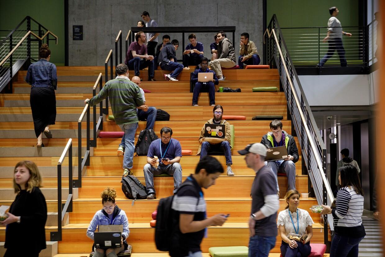 Amazon employees sitting on steps at Amazon's Doppler building.