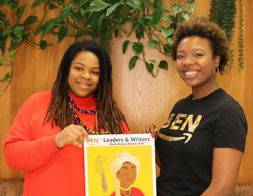 Amazon employee, Aisha Suleiman, holding artwork with artist Onyinye Iwu