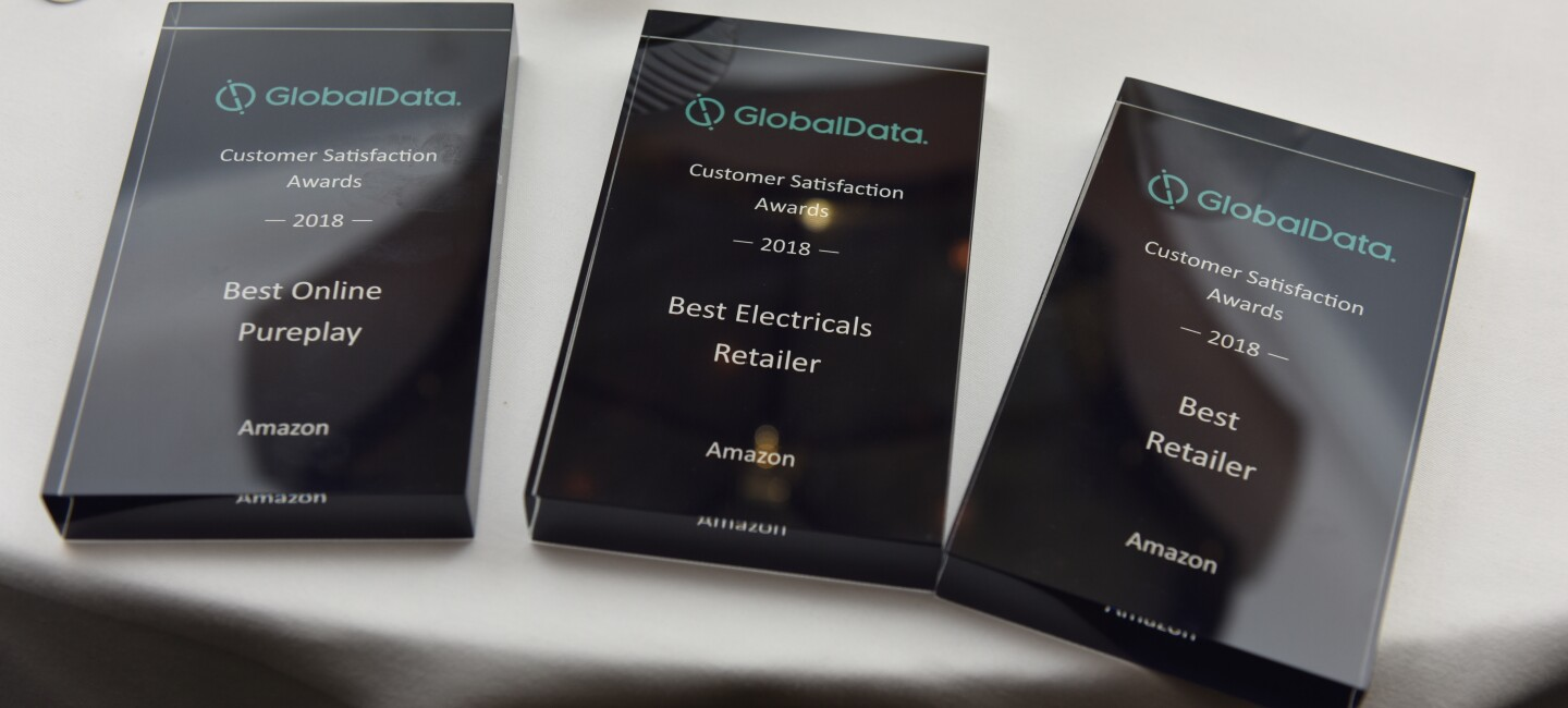 An image of three awards won by Amazon at the GlobalData Customer Satisfaction Awards 2018. The three awards are for Best Online Pureplay, Best Electricals Retailer and Best Retailer.