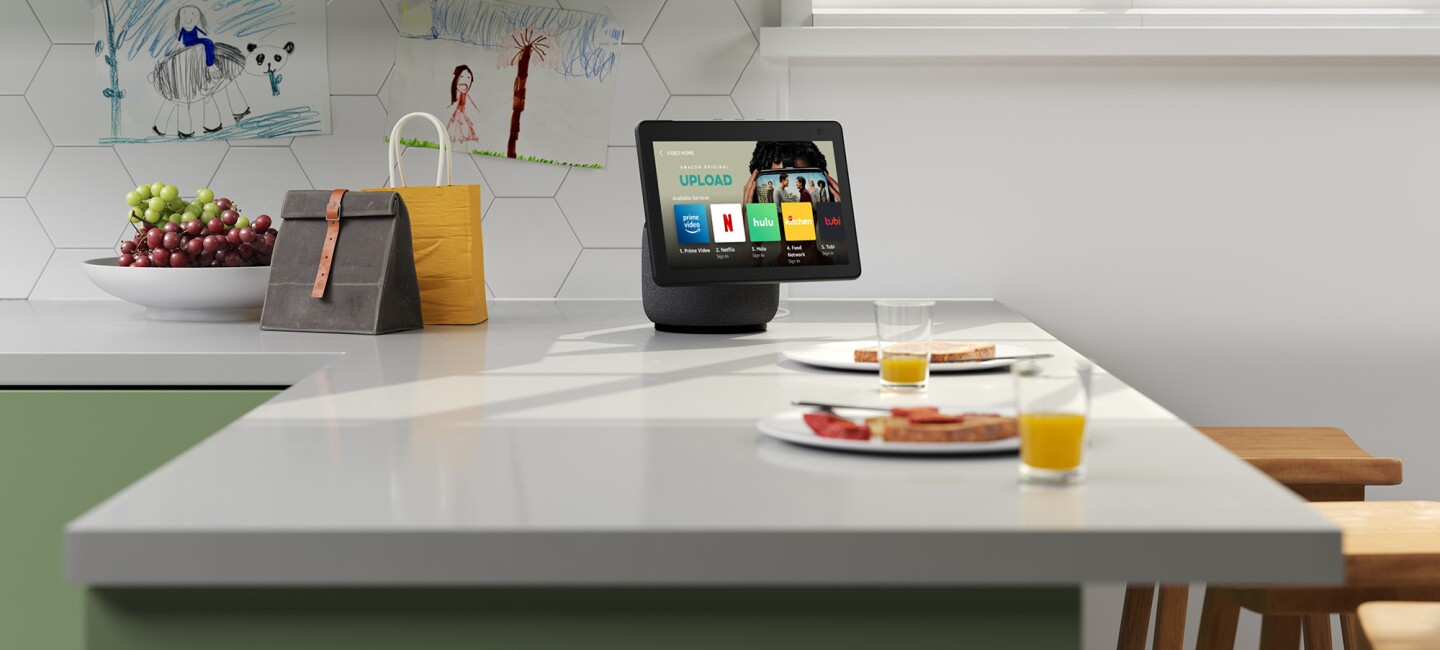 An image of the Echo Show 10 sitting on a kitchen counter top.