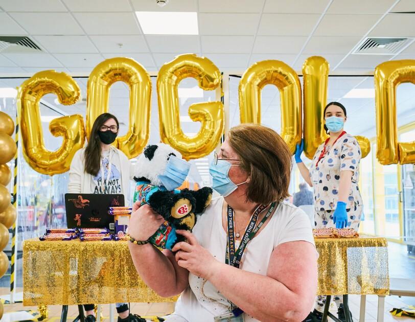 Amazon employees stood next to Goes Gold balloons