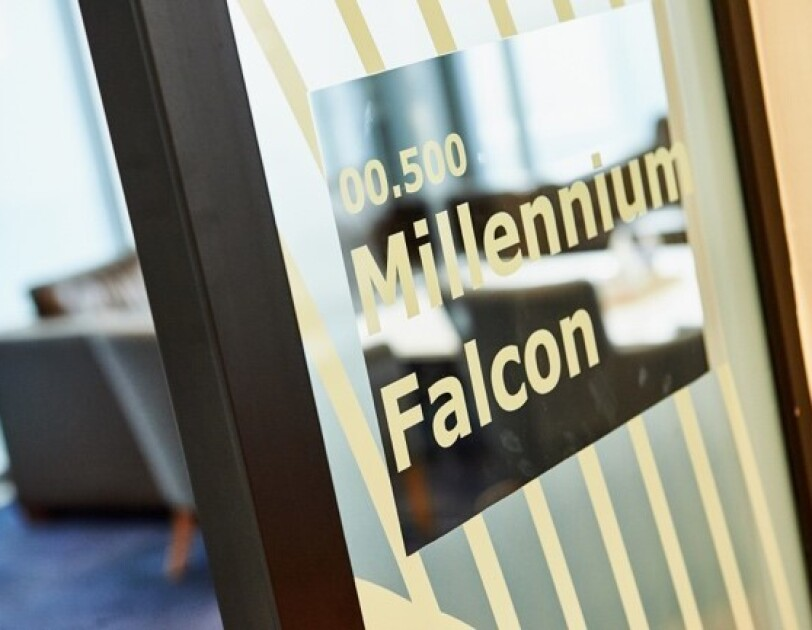 Door of a meeting room at  Amazon's Development Centre Scotland with the name Millennium Falcon