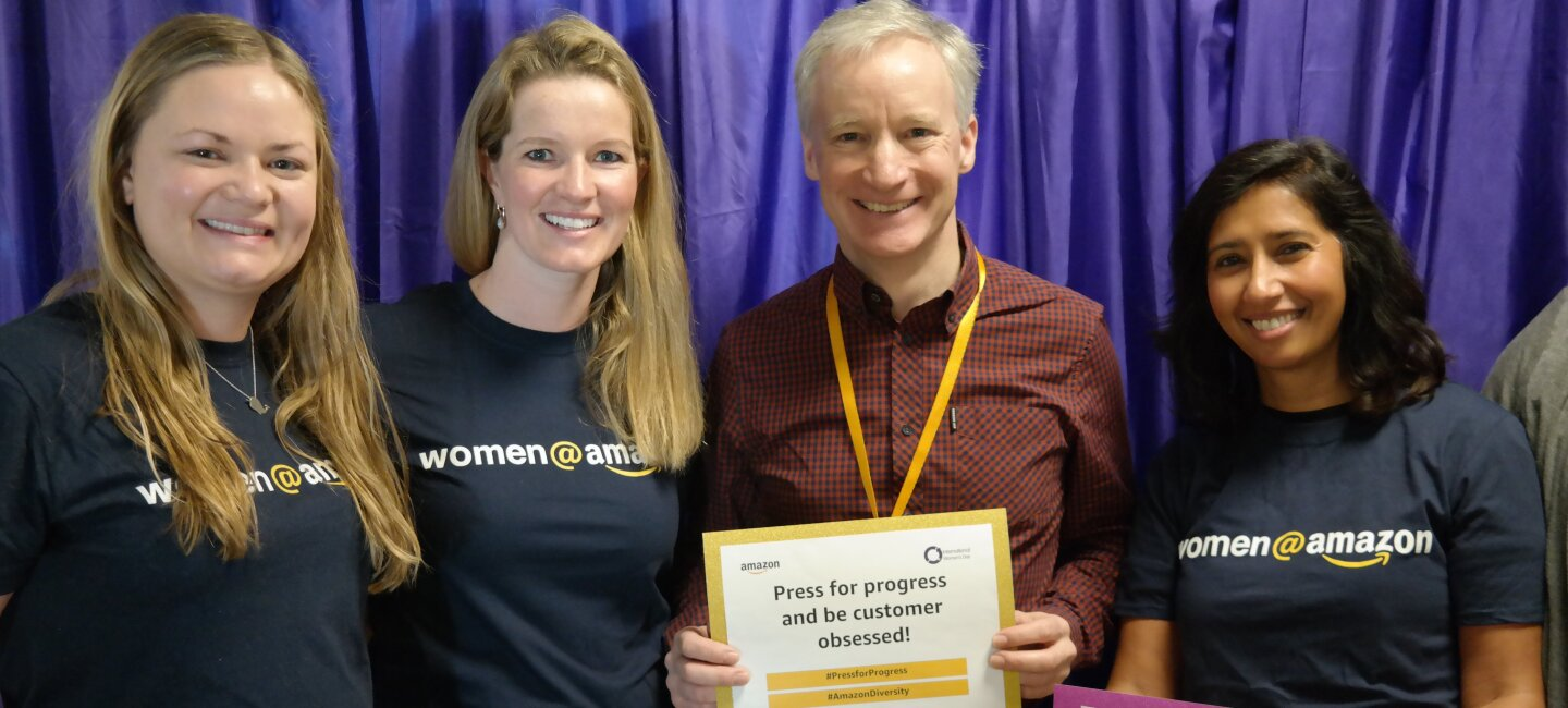 Employees holding certificates at International Women's Day at Amazon