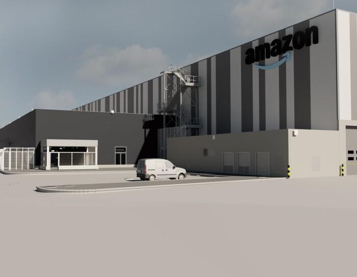 El centro de distribución de Barberá del Vallés será el septimo en Barcelona y el primero de Europa en contar con la pionera tecnología Pegasus. La foto es un montaje realizado en ordenador del aspecto del nuevo centro logístico. Se ve una nave de color gris y blanco con una furgoneta blanca y un camión de color azul.