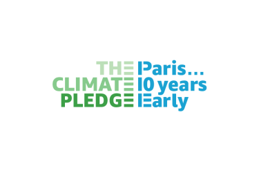 "Logo for The Climate Pledge says ""The Climate Pledge"" in green ""Paris… 10 years early"" in blue."