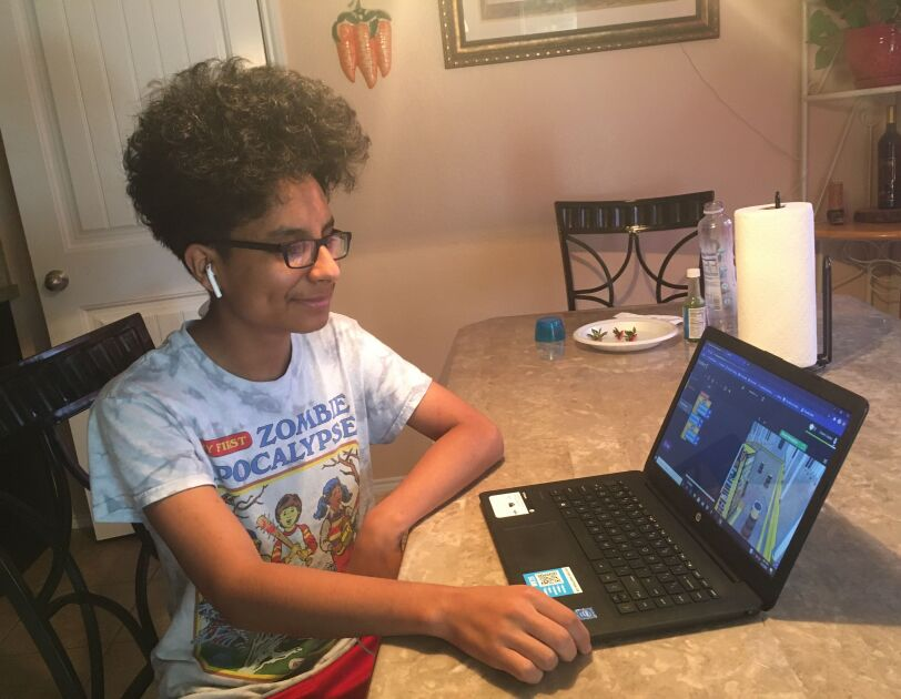 Amazon Future Engineer student learning computer science skills from home.