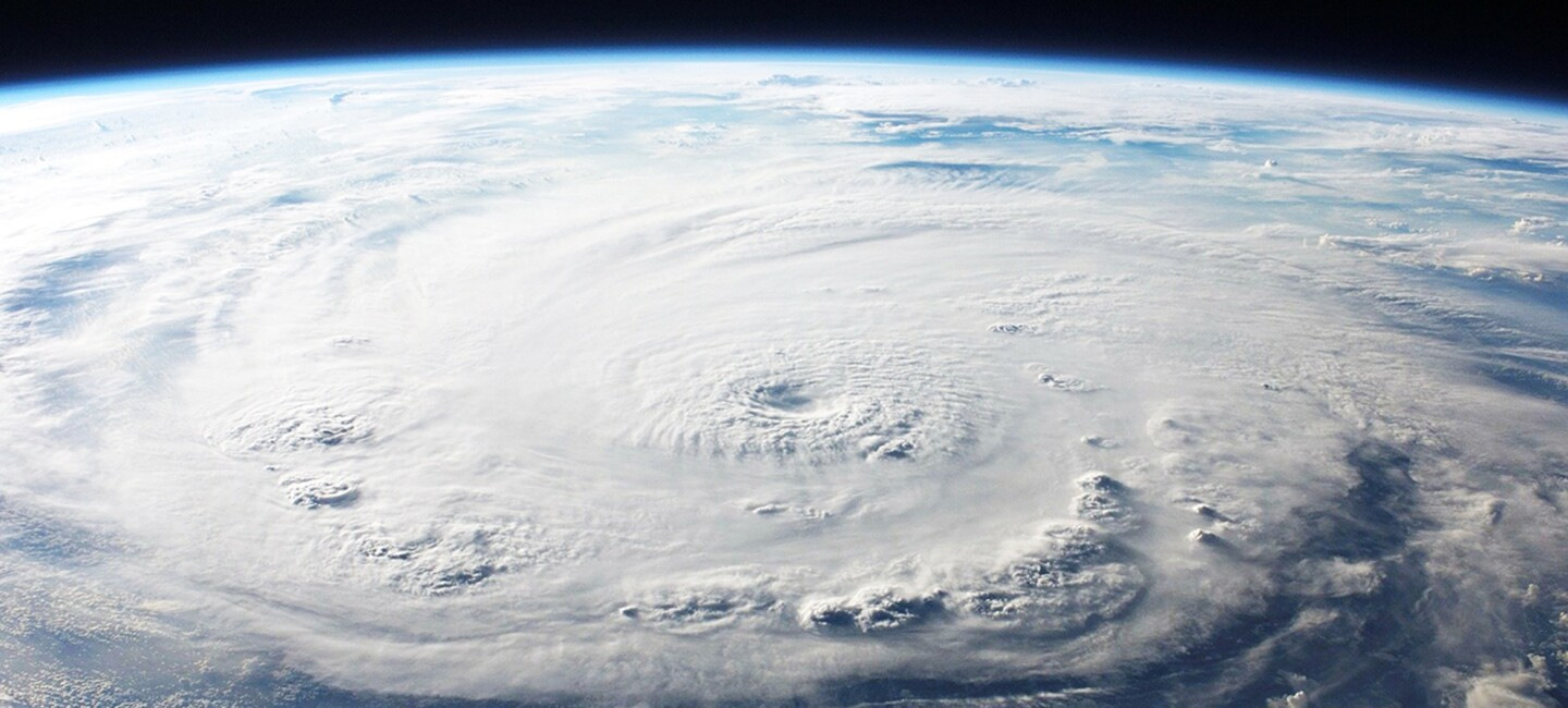Aerial view of a hurricane swirling over the ocean.