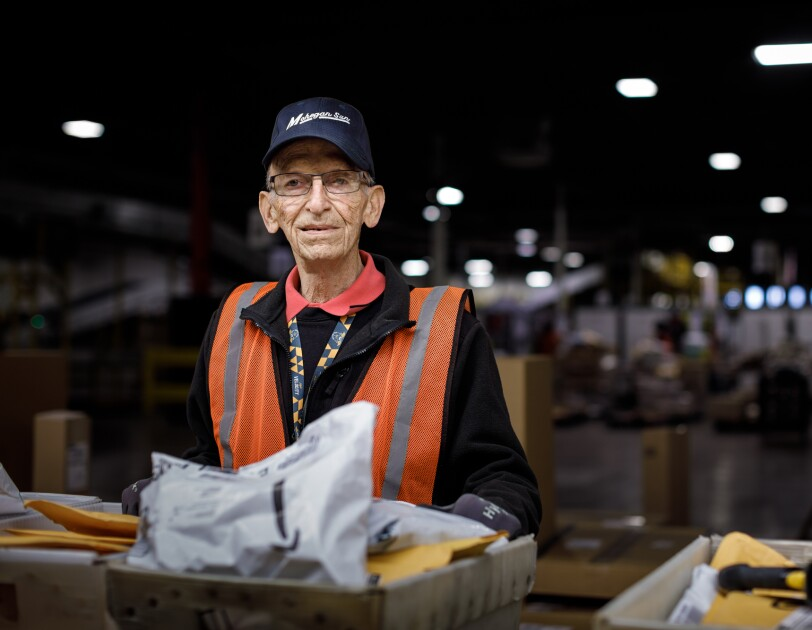 Amazon employee Rick Reefer looks into the camera. He is wearing a cap that says 'Mohegan Sun'.