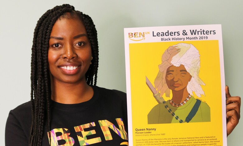 Ramat Tejani, Diversity & Inclusion Marketing Manager, holding artwork of Queen Nanny