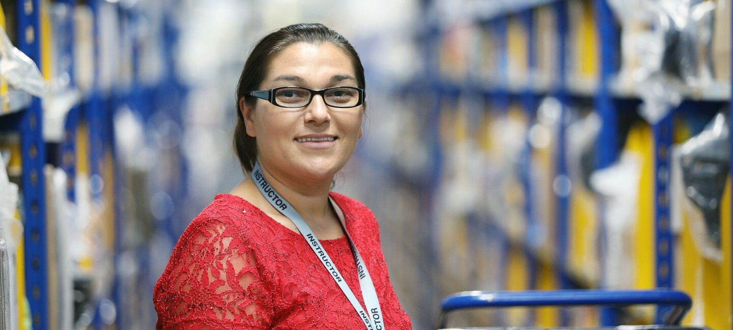 Daniela Cotoros, fulfilment centre employee at Amazon in Milton Keynes, pictured at work