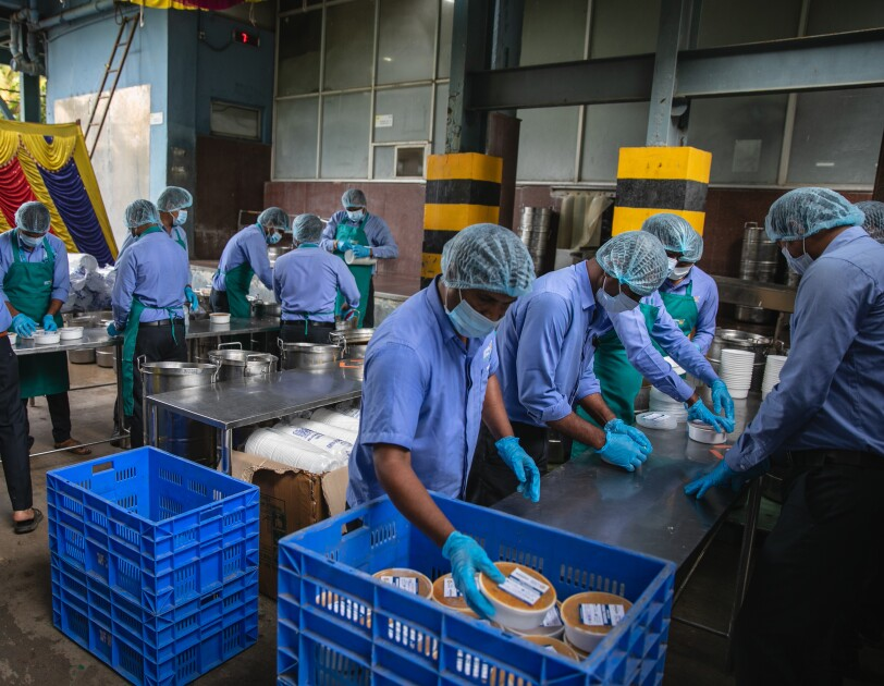 A food distribution drive for creamtorium workers during COVID