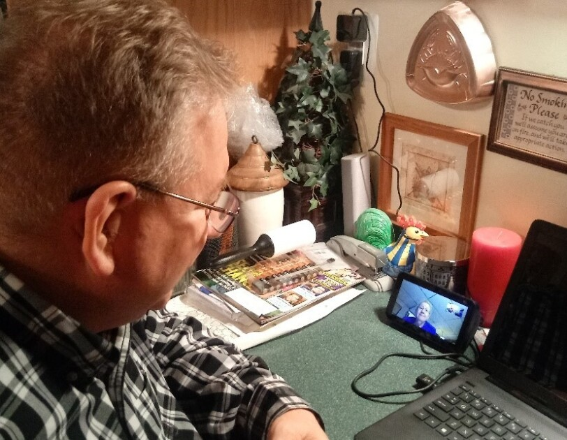 A man talks to his mom on an Echo Show device.