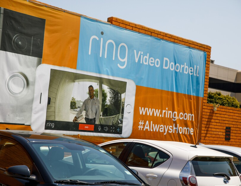 A banner with a screen capture of the Ring video doorbell, with the Ring URL (www.ring.com) and the hashtag #AlwaysHome