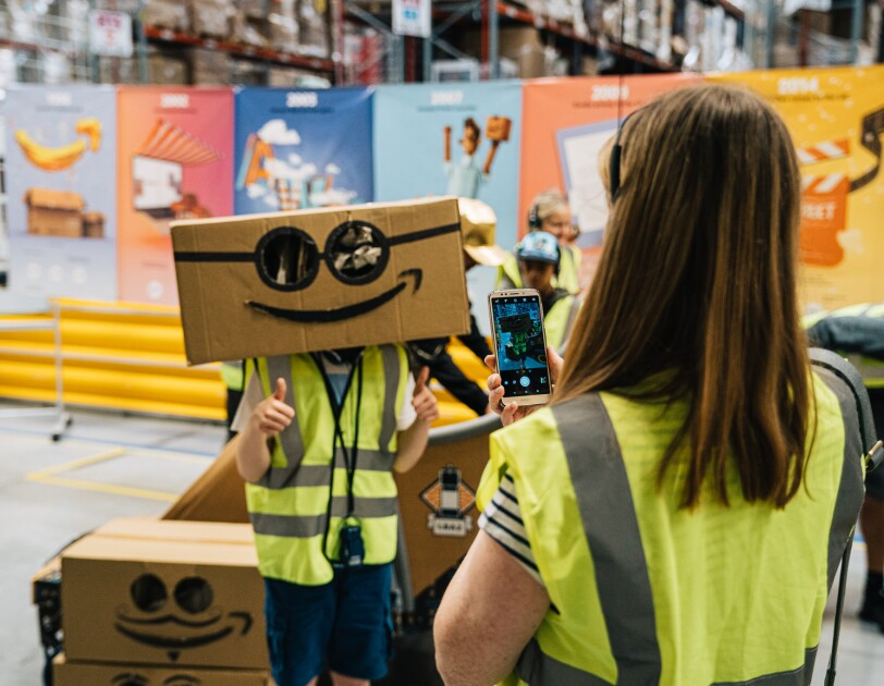 Children with Amazon boxes for Goes Gold Doncaster