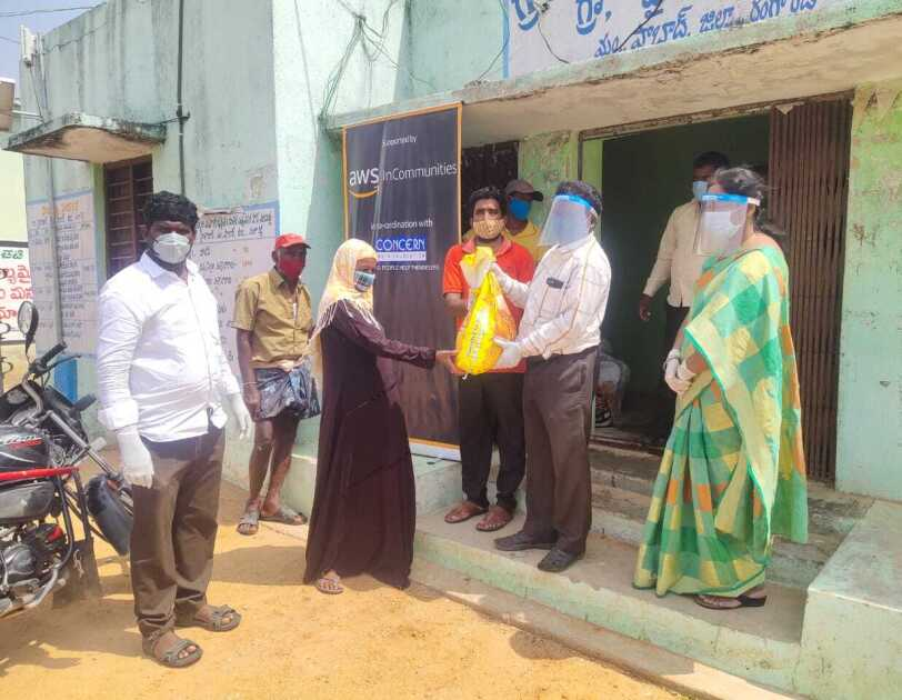 AWS in communities Telangana - a woman receiving dry ration