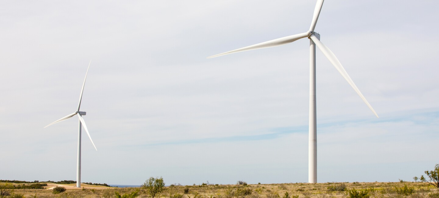 An image of an Amazon windfarm in a field in Texas